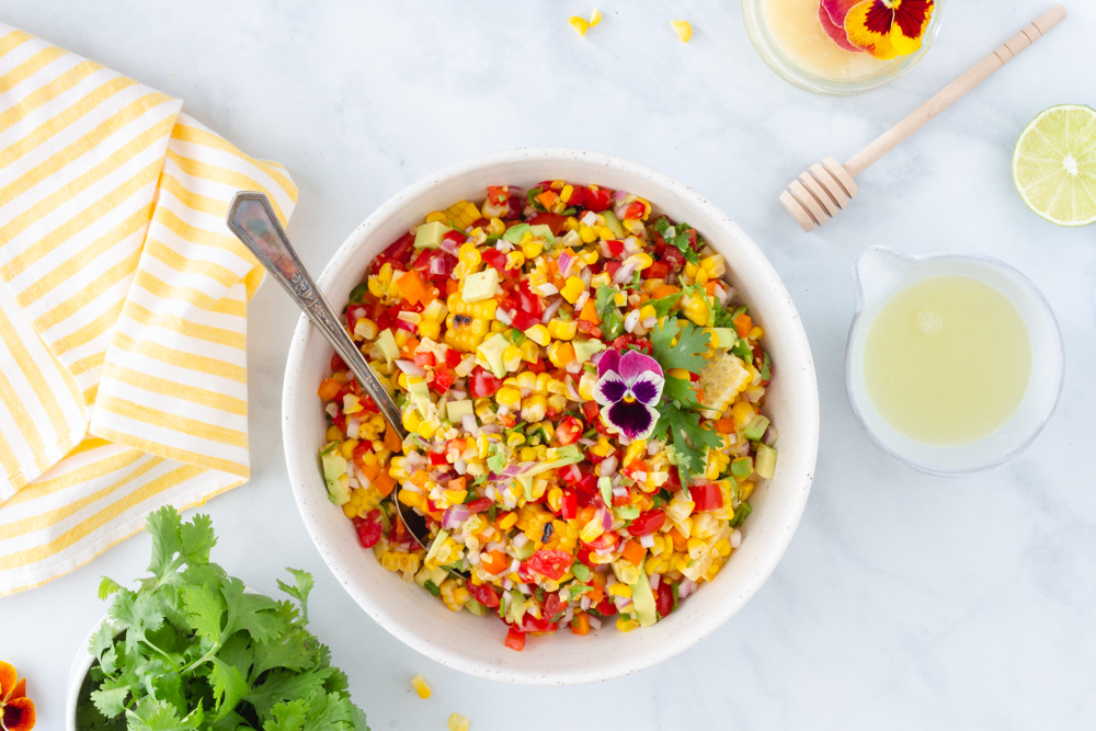 Summery, fresh, colourful corn salad served family style