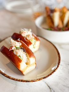 Luscious crab and shrimp filling dotted with cucumber nestled in a mini, glistening, top-cut brioche bun. Times two.