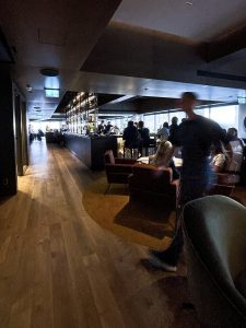 A dark and moody capture of the hustle and bustle of the bar.